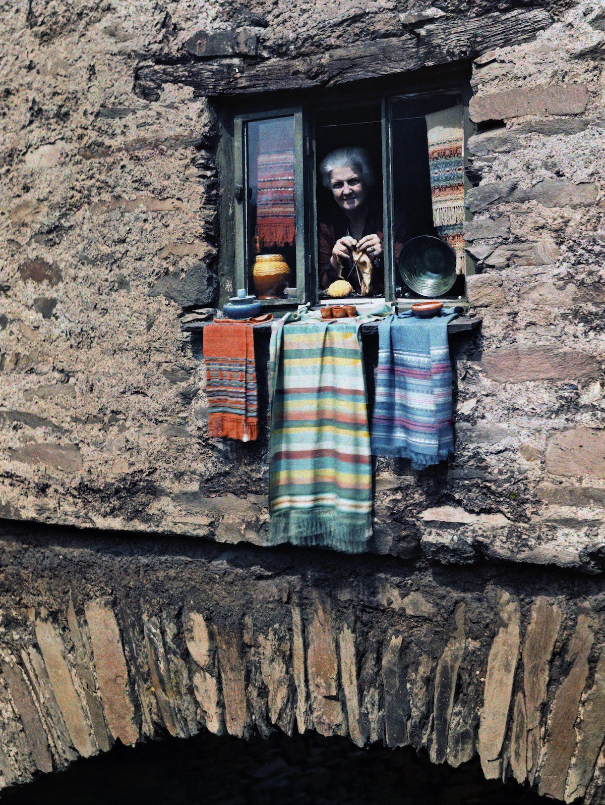 A woman sticks her head out of her bridge house window, in Ambleside, Lake District, Cumbria, England. Image: Clifton R. Adams/National Geographic Creative/Corbis